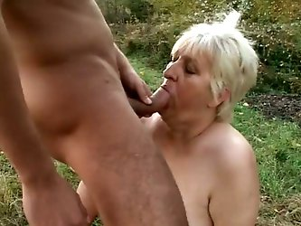 It is amazing to observe sex fetishes of some people. This BBW white granny is a sex slave outdoors for this man in the mask and he makes her suck his