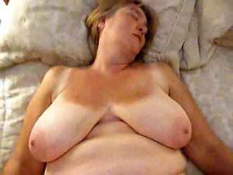My mature blonde wife is under me getting polished missionary style. She has huge flabby knockers and a big layer of fat on her belly.