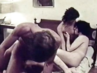 Two horny swinger couples fucking together in vintage sex scene