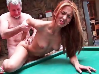 Brunette is having some hot sex on the pool table here