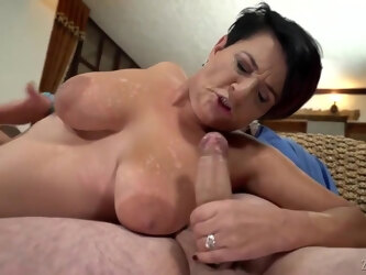 Busty mature brunette, Dolly Bee is having amazing sex with a new neighbor and enjoying it