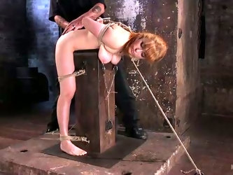 Bent over redhead Penny Pax gets metal anal plug inserted into her butt