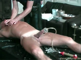 Blond hunk gets his cock pumped and tortured with hot candle wax