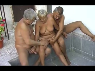 This threesome is between slutty mature lady and two mature dudes. The old farts rub her pussy with their fingers and she sucks their dicks.
