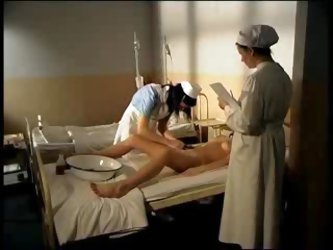 Nurses playing with a female patient