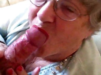 Granny puts on her lipstick then sucks young cock