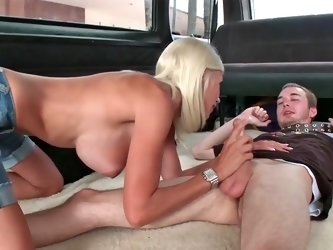 Big titted blonde is giving pleasure to a skinny guy