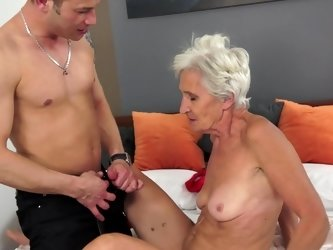 A granny is getting her pussy stretched wide open by a young cock