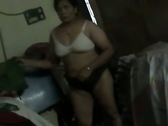She lets me feel and touch her titties because she is a horny milf. My Indian auntie changes clothes while I film her on cam.