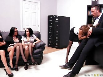 Watch these four hot brunettes fighting for a promotion and each one is hotter than the other. Look how one of them starts sucking his hard cock in fr