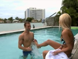 Blonde fools around in the pool with an athletic dude that she likes