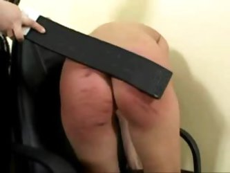Her ass gets caned and it looks painful