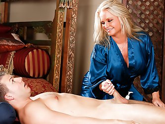 Maya Devine massaging a much younger guy