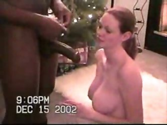 Curvy ginger wife of mine is on her knees over the Xmas tree all naked sucks this 11 inch black meat pole. Even that black cock's head hardly fit