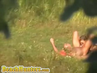 Dressed slut being humped by an bald guy at field