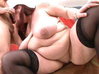 Chubby granny sucking on a nice hard cock !