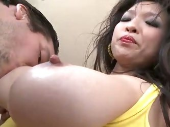 Asian babe pleases a hard cock with her big tits