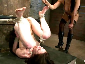 Bound Juliette March gets toyed and whipped by Isis Love