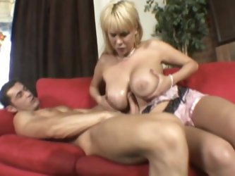 Carly Parker titfucks a cock and enjoys banging in many positions