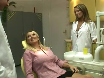 This blonde lesbian dentist is really hot, just like her patient, so the girl on girl action going on with dildos and pussy licking is awesome....
