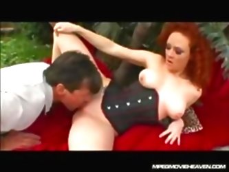 Redhead In Her Corset Gets Her P...
