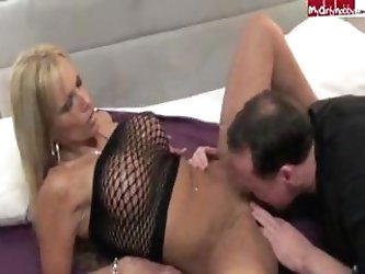 Horny blonde bimbo with big boobs milks the cream of a cock onto her tits
