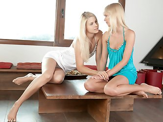 Two equally pretty blondes spend a beautiful Sunday morning lounging and getting naughty on the living room.