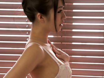 Mind taking Japanese babe mauls her slender body in steamy white lingerie before she stands by the table to rub her bearded vagina with fingers in siz