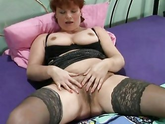 This mature lady with her big boobs is in her room and naked. She is fingering her large pussy with all the fingers of both of her hands to make it we