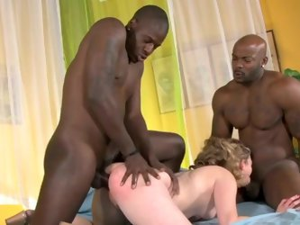 Young blonde haired white girlie gets banged hard by two black guys, as she sucks one cocks the other guy fucks her tight pussy from behind.