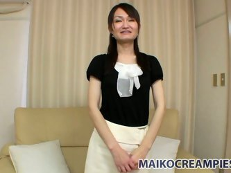 Getting undressed this brunette doesn't mind getting poked right away. Rubbing her clit right through wet panties makes this Japanese milf too ho
