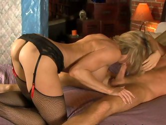 This nerdy skinny guy is an easy prey for experienced cougar Brandi Love. She seduces him into her bedroom and blows his cock before riding him!