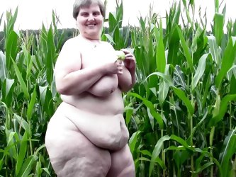 Redneck whore Tina is one of those bbw with a lot of lust. She's in the corn field and starts acting naughty. Her big, fat pussy needs some fucki