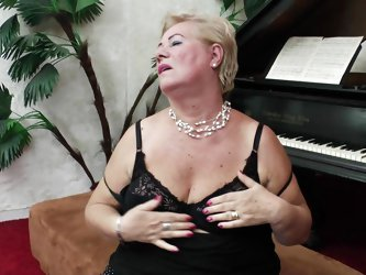She's still sexy, although she passed 60 and has a lot of experience this gilf plays the piano probably as good as she handles cock. Look at her,