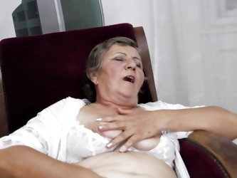 See this short haired granny masturbating in her room. She is alone and she needs to calm the bitch inside her who needs cocks to fuck. So this lady h
