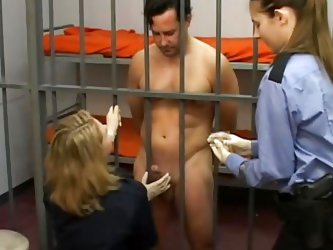 Gary is in prison. Prison guards Kristen and Bettie make him strip naked to ensure he is not hiding any contraband. He takes of his underwear to revea