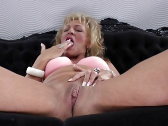 This mature blonde feels really horny and seems, like it would be a good time, to rub her pussy. She takes her jeans down, gently touching her pussy.