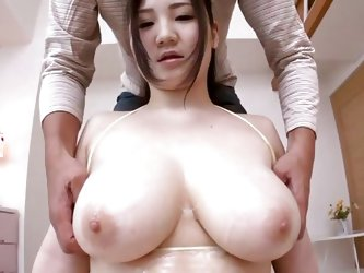 The bra barely holds her big soft milky white boobs and oiled too. This guy want to give us a nice show so he takes out those breasts and massages in