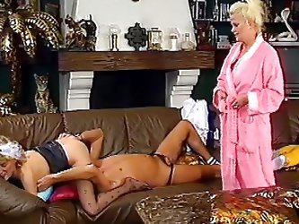This German guy is laying on the couch, eating his wife's pussy when their neighbor walks in on them, to join the fun. She sucks on his cock and