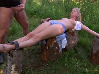 Old pervert makes out with a fresh-faced babe in forest. He crucifies her on the stubs with her head hanging upside down for a deepthroat blowjob.