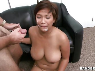 Reina is a thick Asian babe with big natural tits that are oiled and bouncing as she rides a cock. Then she gets her cookie poked from behind, followe