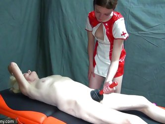 This nurse is wearing her latex outfit and taking care of this old nanny as she lies on the table. The nurse plunges the old lady's pussy to get