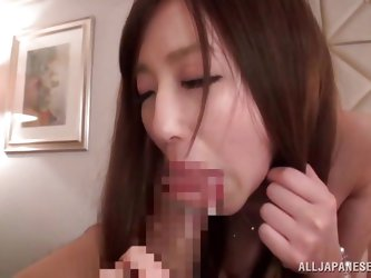 This cute Japanese babe has a craving for cock. She lays back on the couch and opens her legs so her man can finger that juicy, hairy cunt of hers. No