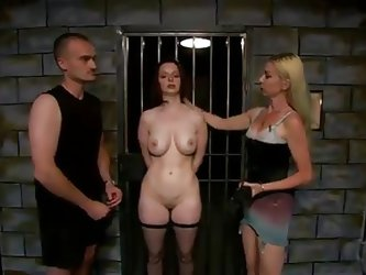 Mistress Erzebet is a blonde mature who enjoys punishing young ladies, like that brunette. In an interview she shows around her torture tools, and the