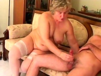 Old granny all naked and wearing sexy tight vest dives her fingers into her all wet and itchy pussy rubbing and drilling to please her and then gets f