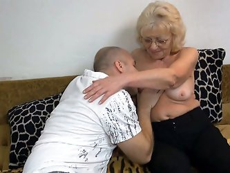 Lovely granny reads porn magazine with her young lover. Then granny gets naked letting her stud eat her stinky hairy snatch and suck her saggy tits.