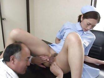 Slim and shy the pretty nurse Yuri is patiently waiting for her doc. She sits on his desk and the old doctor spreads her thighs and gapes her hairy va
