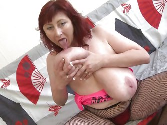 Busty redhead Jana shows us her big jugs and how she likes playing with them. The fucking whore has a pair of huge boobs with big pink nipples, perfec
