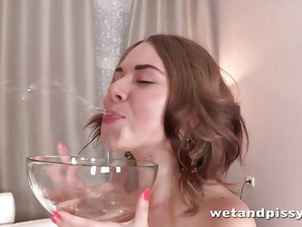 Watch as this whore plays with her own urine. She plays with her cunt and pisses all over her chair. She sits int he warm pee and soaks her pantyhose.