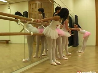 Young Euro ballerinas show off their tight tits to each other